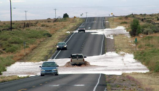 A thunderstorm Monday afternoon caused flash flooding along portions of New Mexico Highway 605 near the village of San Mateo. Other areas of the roadway were covered with hail, creating hazardous driving conditions.