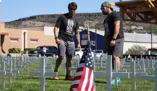 Will Owens and Dustin Schnatz pause at the Field of Honor in Grants while on their 3,000 mile run from California to Virginia Friday.