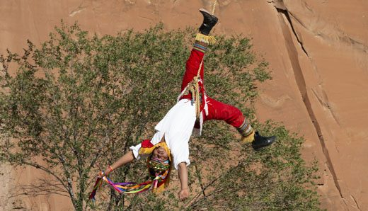 Luis Felipe Santes Perez, 51, looks to see where he will begin to turn to slowdown his team of  Los Voladores at the 97th Inter-Tribal Indian Ceremonial Saturday in Gallup.