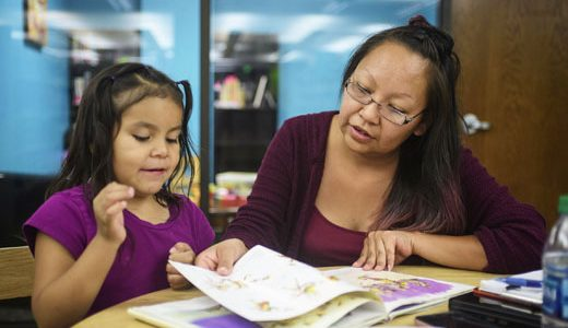 Felicia Wilson reads to her daughter Monique Perez, 5, at the Octavia Fellin Public Library Childrens Branch in Gallup, Wednesday, July 11.