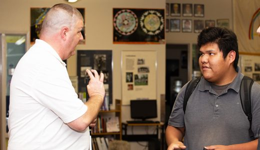 U.S. Marine Corps veteran, author and motivational speaker Michael L. Jernigan, left, talks about the Marines and the future with Jayden Kinsel, 16, Thursday at Miyamura High School in Gallup.