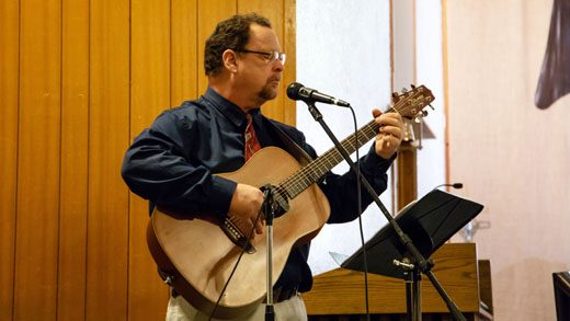 Director Thomas Breece of the Gallup Music Teachers Ensemble sings a few songs of worship during the groups performance Thursday evening at the St. Francis of Assisi Church.